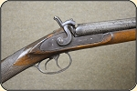 Price Reduced Unusually long barreled double barrel shot gun