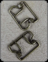 Buckle - Two tine brass colored one inch buckles. 6 or 12 pack