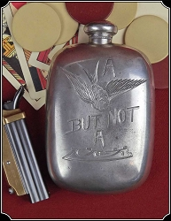 Engraved whiskey flask, With  a motto.